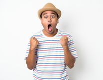 Young Asian man with hat feels shock and surprise with overly face expression. Asian man with hat feels shock and surprise with overly face expression stock photo