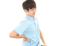 Asian man having back pain Royalty Free Stock Photo