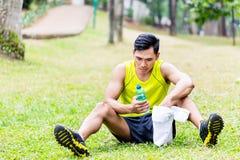 Asian man having break from sport training Stock Photography