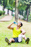 Asian man having break from sport training Royalty Free Stock Images