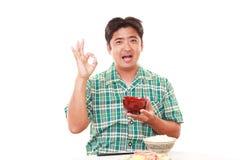 Asian man having breakfast Royalty Free Stock Photos