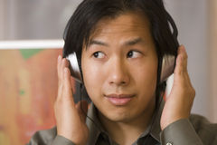 Asian man with headphones Royalty Free Stock Photography