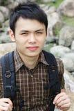 Asian man hiking Royalty Free Stock Photo