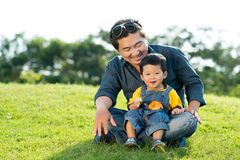 Asian man and his little son Royalty Free Stock Photography