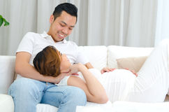 Asian man and his pregnant wife Stock Images