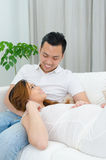 Asian man and his pregnant wife Royalty Free Stock Photo