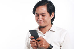 Asian Man With His Smart Phone Royalty Free Stock Photography