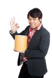 Asian man hold a blank bucket and show OK sign Stock Photo