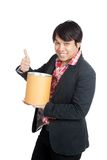 Asian man hold a blank bucket and thumbs up Royalty Free Stock Photos