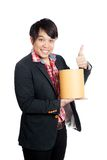 Asian man hold a blank bucket and thumbs up Stock Photo