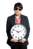 Asian man hold a clock in font of him Royalty Free Stock Images