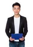 Asian man hold with file pad Stock Photography