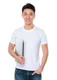 Asian man hold with laptop computer Royalty Free Stock Image