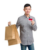 Asian Man hold with paper bag and credit card Stock Photography