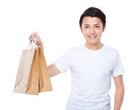 Asian man hold with paper bag Stock Images