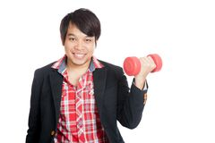 Asian man hold red dumbbell and smile Royalty Free Stock Photo