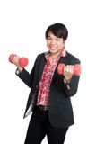 Asian man hold red dumbbells with both hands and smile Royalty Free Stock Images