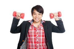 Asian man hold red dumbbells with both hands and smile Royalty Free Stock Photo