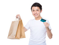 Asian man hold with shopping bag and credit card Royalty Free Stock Photos
