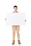Asian man holding a blank board Royalty Free Stock Images