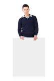 Asian man holding a blank board Stock Photo