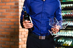 Asian man holding bottle of wine Stock Photography