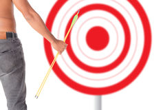 Asian man holding bow and shooting to archery target. Stock Photo