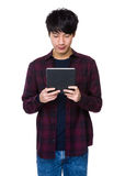 Asian man holding a digital touch screen tablet computer Stock Photography