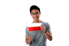 Asian man holding flag of Poland Stock Photo