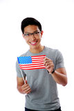 Asian man holding flag of USA Royalty Free Stock Photography