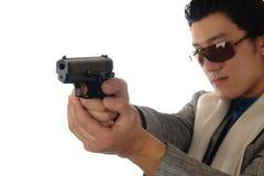 Asian man holding gun Royalty Free Stock Images
