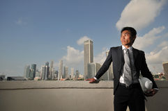 Asian Man holding a hard hat Stock Images