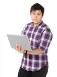 Asian man holding laptop computer Royalty Free Stock Image