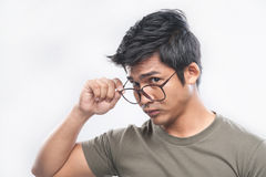 Asian man holding nerdy glasses Stock Images