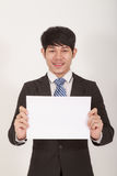 Asian Man Holding Paper Royalty Free Stock Image