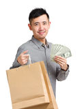 Asian man holding shopping bag with cash Royalty Free Stock Image