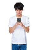 Asian man holding smart phone Stock Photo