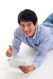 Asian man holding tablet computer Stock Photos