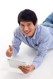 Asian man holding tablet computer Stock Photos