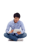 Asian man holding tablet computer Royalty Free Stock Images