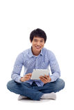 Asian man holding tablet computer Royalty Free Stock Photo