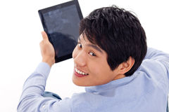 Asian man holding tablet computer Royalty Free Stock Photography