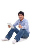 Asian man holding tablet computer isolated Royalty Free Stock Photo