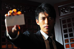 Asian Man Holds Business Card Stock Photo