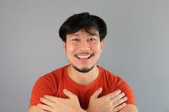 Asian man hugs. Royalty Free Stock Photo