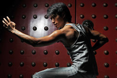 Asian Man In Fighting Action Royalty Free Stock Photo