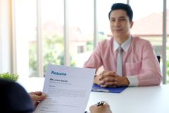 Asian man in job interview at office background, job search, bus stock images