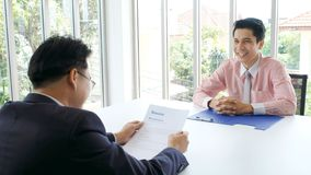 Asian man in job interview at office background, job search, business concept. Asian men in job interview at office background, job search and business concept stock photography