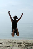 Asian Man Jumping on Beach lifestyle Portrait Stock Photo
