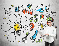 Asian man with laptop and colorful startup sketch Royalty Free Stock Photo